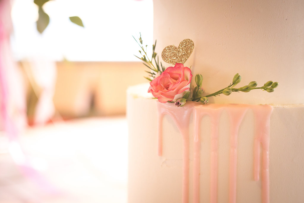 Closeup of cake made by  @annie_bee_cakery  flower from  @willowspecialtyflorist  and gold heart cake topper donated by  @mypapercrush