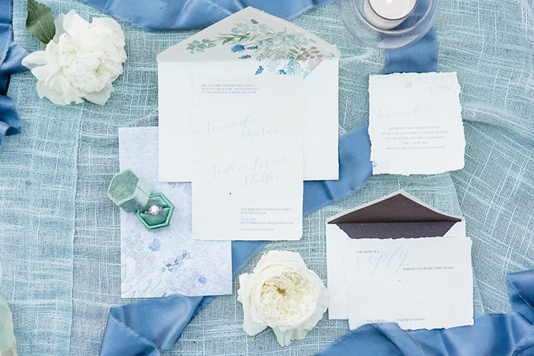 Rustic chic wedding invitations, woodgrain paper, vellum and handmade paper. Custom watercolor artwork and calligraphy for a completely one-of-a-kind wedding invitation