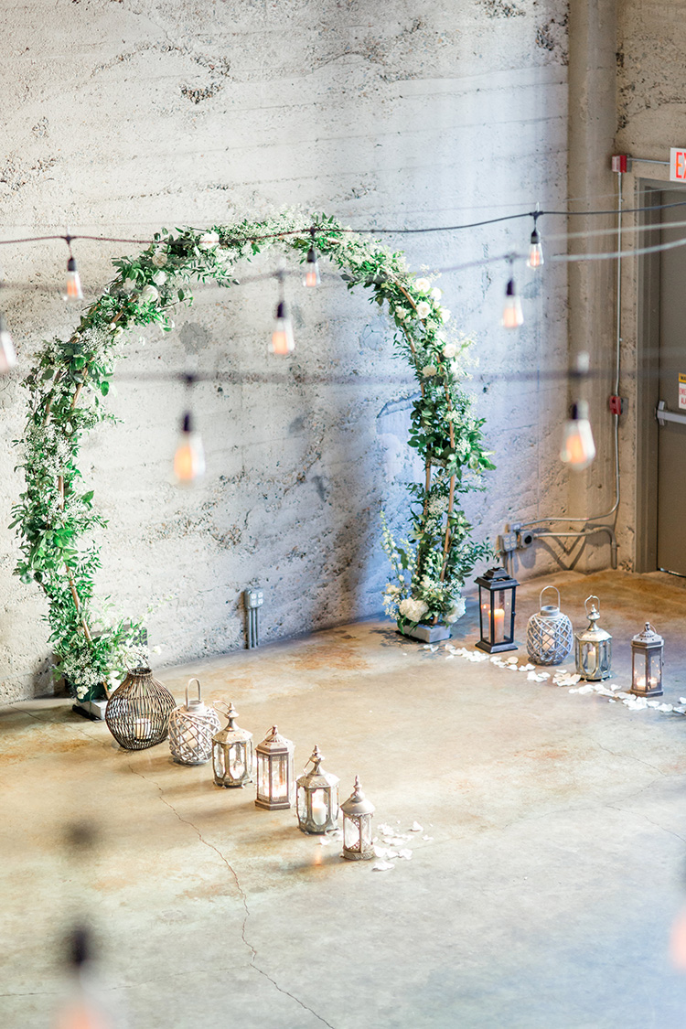 Wedding arch, rustic chic decor. Indoor ceremony ideas. Gorgeous greenery covered wedding arch