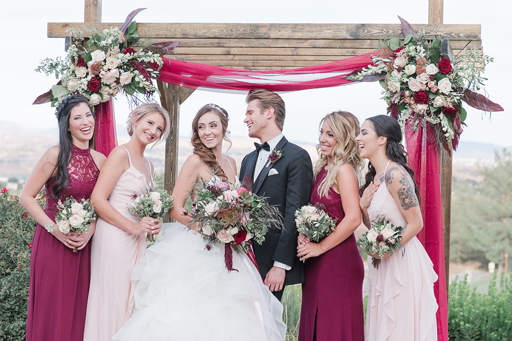 Unique wedding arch perfect for this outdoor vineyard wedding in California.