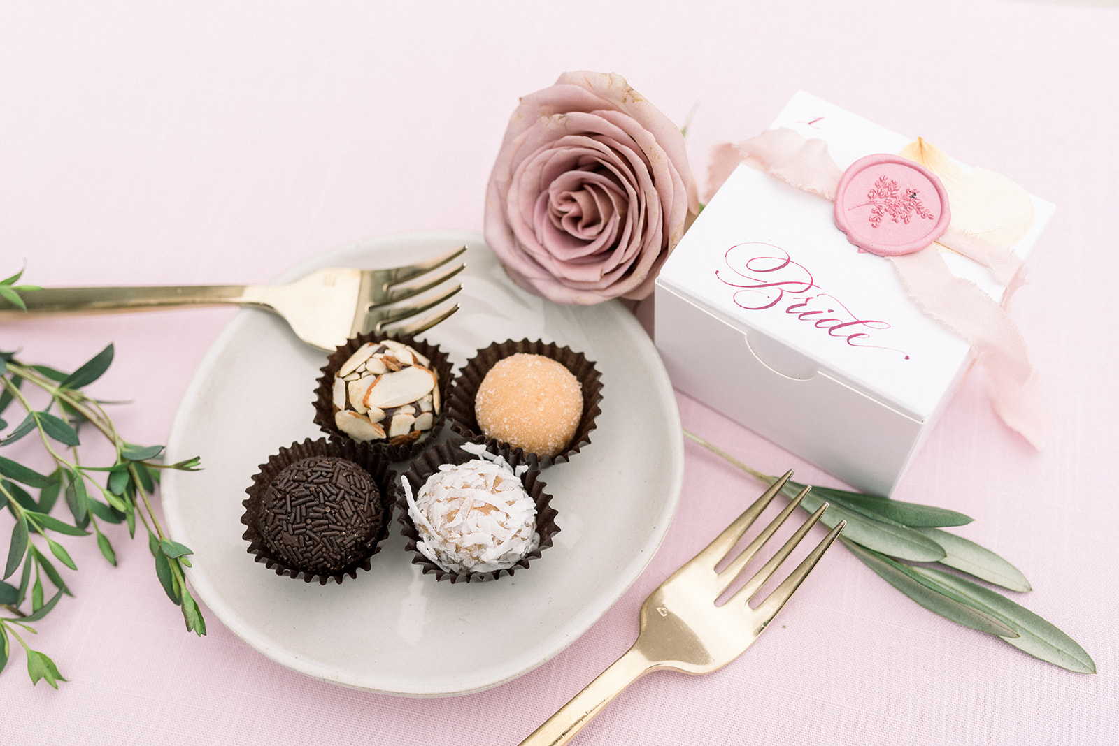 Unique wedding favor, truffles packaged sweetly into each guests custom calligraphy gift box