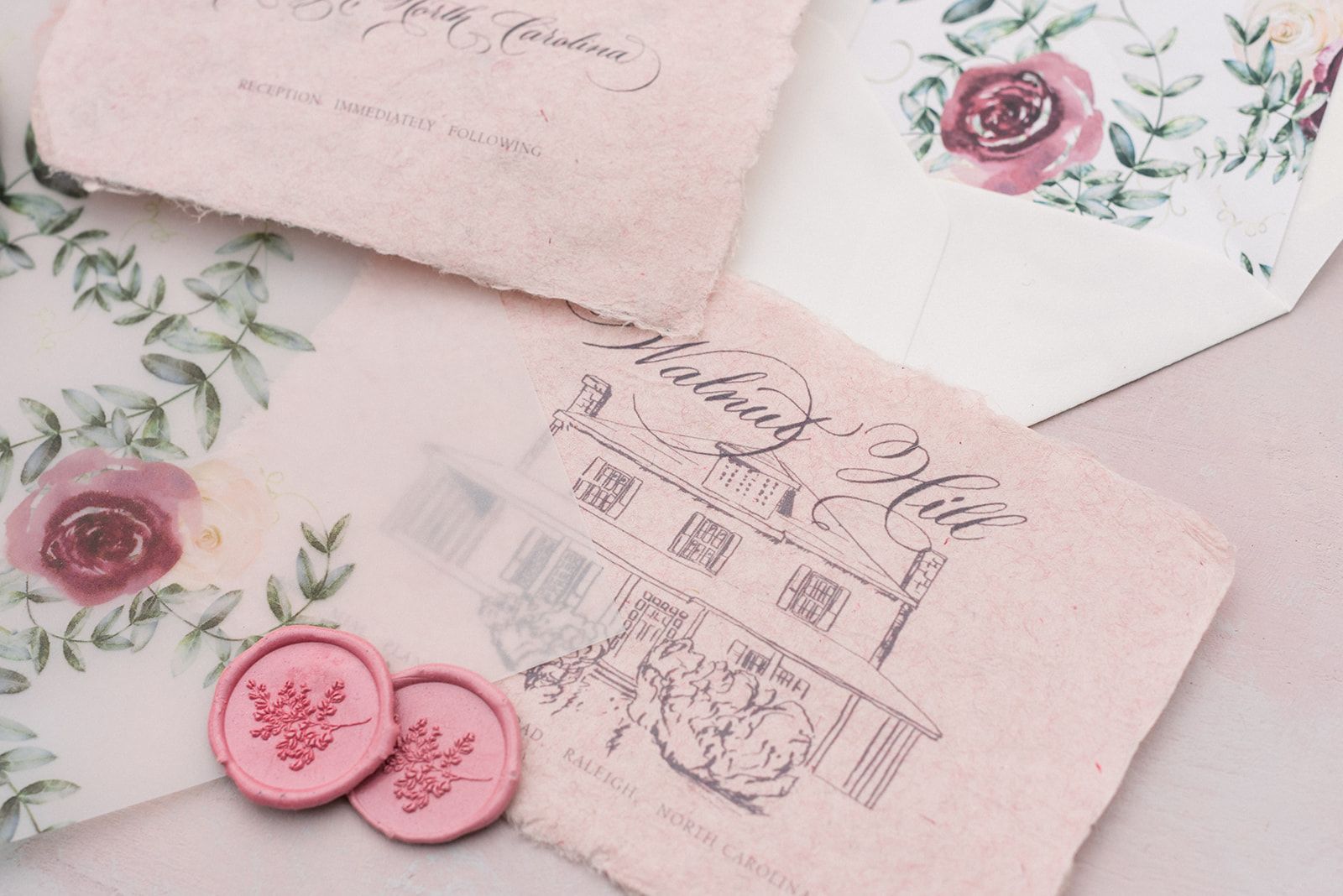 Vellum folder wrap  for wedding invitation with printed watercolor details and handmade paper. Blush and Blue Designs.