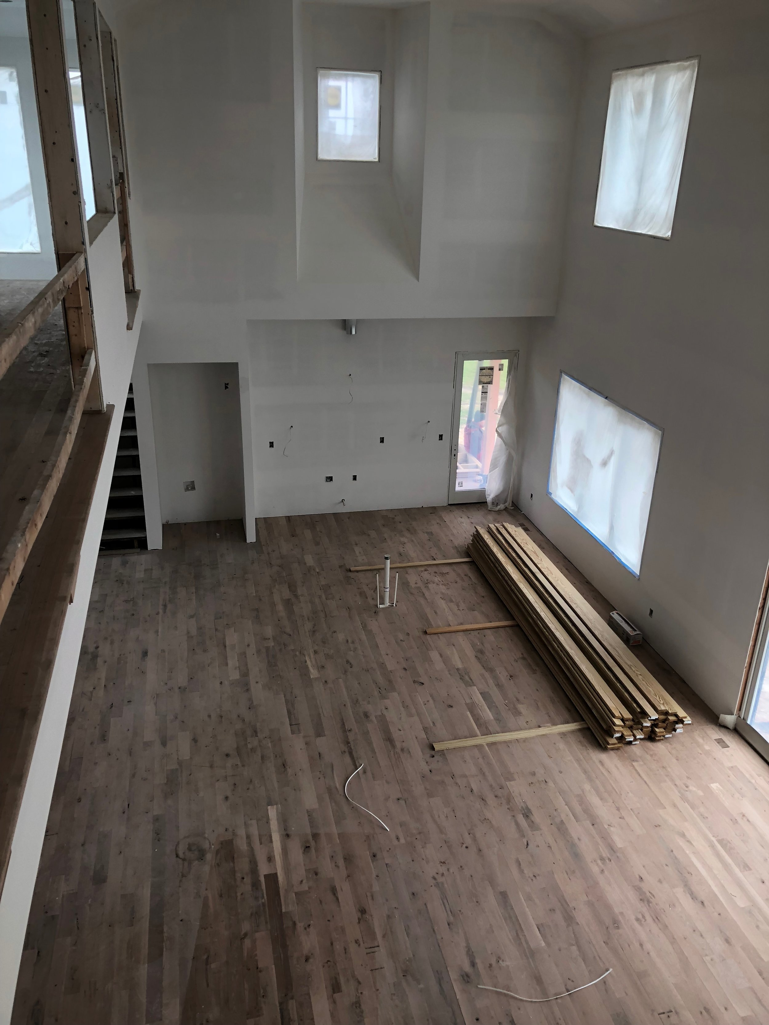 Looking down from the upstairs loft on the great room floors. The #2 quarter sawn oak looks awesome!