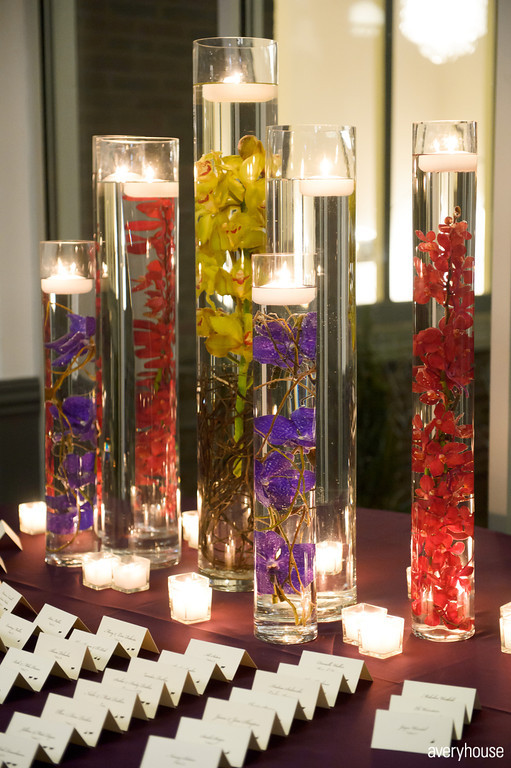 19. The Ivy Room. Avery House. Sweetchic Events. Flower Firm. Escort Card Table. Red, Yellow, Purple Sumberged Orchids and Culry Willow.