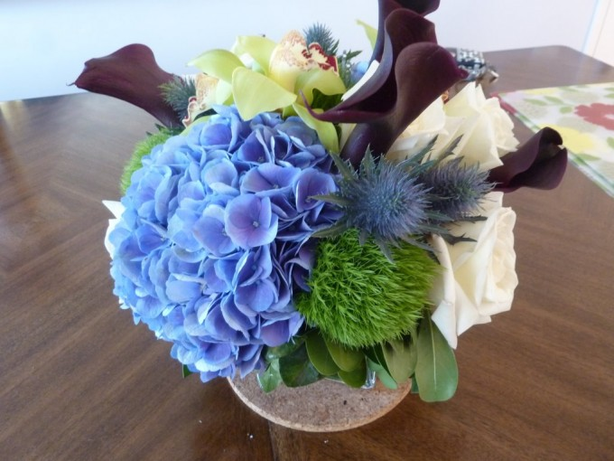 Low centerpiece green trick calla lilies hydrangea orchids roses