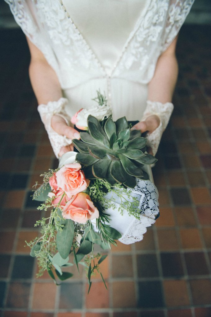 Ida Noyes Theater Wedding. Rose Tinted Lens Photography. Sweetchic Events. Flor Del Monte. Green Succulent, Peach Spray Rose, Rosemary details on rosary wrapped book.