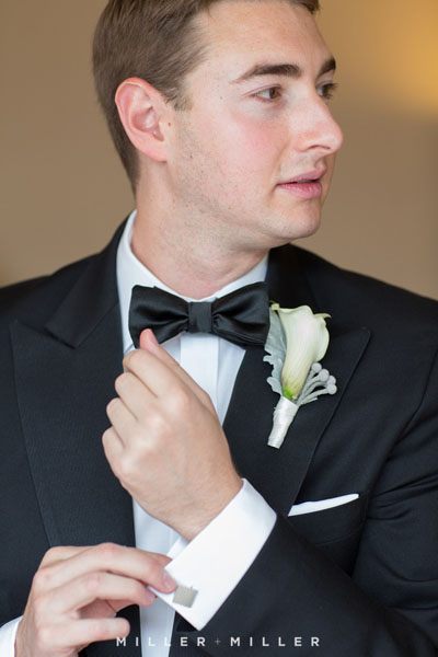 8. Germania Place Wedding. Miller & Miller Photography. Sweetchic Events. Groom fixing cuff links.