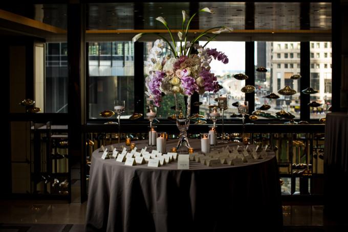 22. Langham Chicago Wedding. Steve Koo Photography. Sweetchic Events. Revel Decor. Escort Card Table. Trumpet Glass Vase Arrangement. Orchids, Calla Lillies, Hydrangea, Roses. Blush.