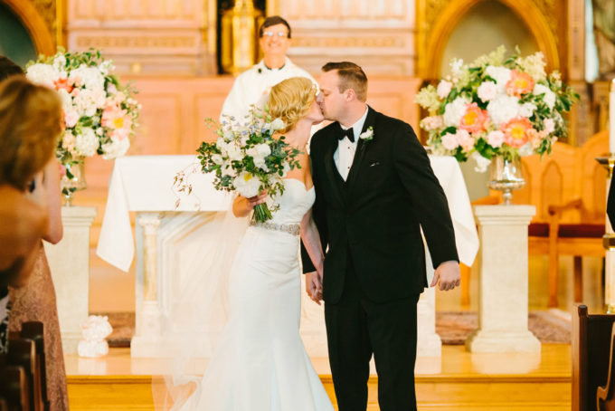 13-blackstone-chicago-wedding-pen-carlson-sweetchic-events-vale-of-enna-church-ceremony-altar-kiss-peonies-roses-ivy
