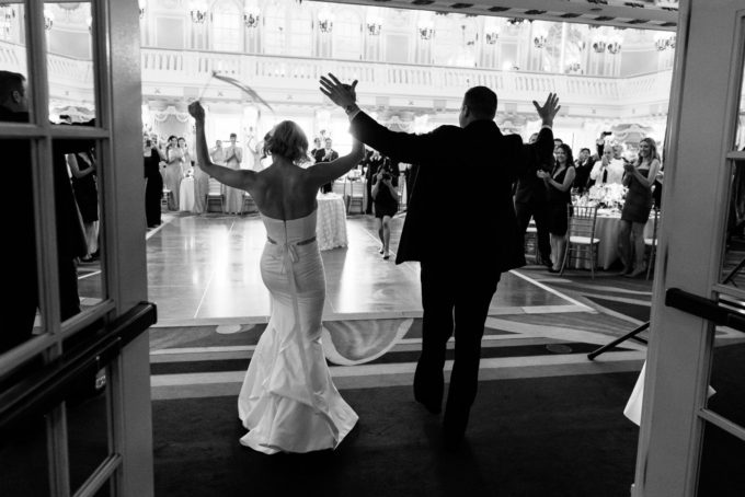 36-blackstone-chicago-wedding-pen-carlson-sweetchic-events-bride-and-groom-introductions-hotel-ballroom-black-and-white