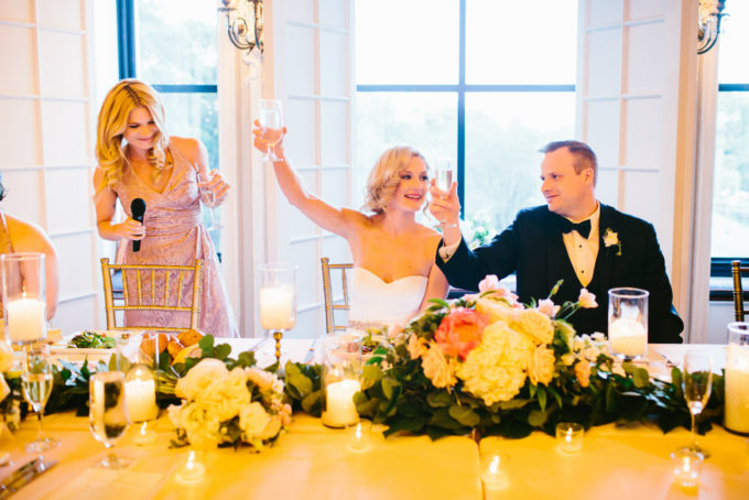 39-blackstone-chicago-wedding-pen-carlson-sweetchic-events-bride-and-groom-maid-of-honor-toast-cheers-garland-head-table