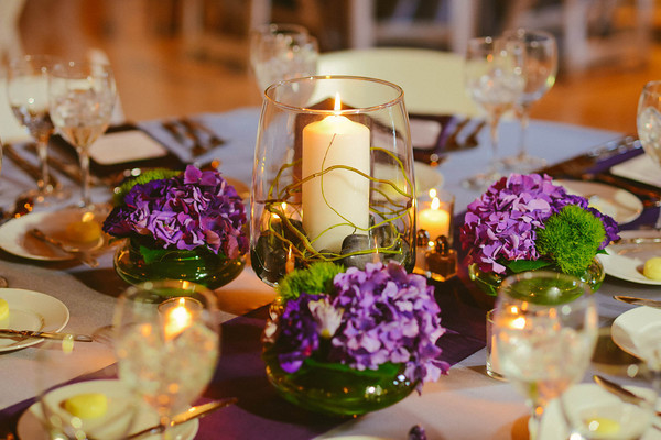 6. Karen.Boris.River East Art Center. Fragola Productions. Sweetchic Events. Flower Firm. Pillar in Hurricane with Purple Hydrangea and Green Trick.