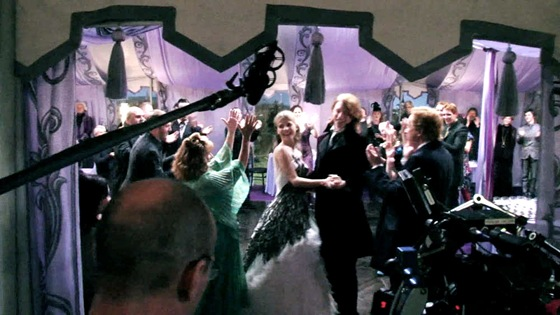 HP7 Bill Fleur wedding tent interior purple uplighting  Source