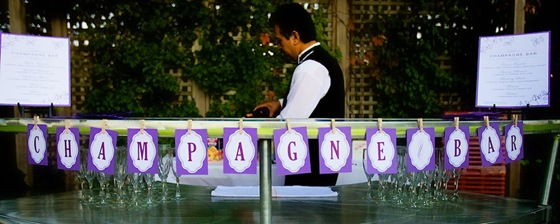 galleria marchetti wedding purple champagne bar sign 2
