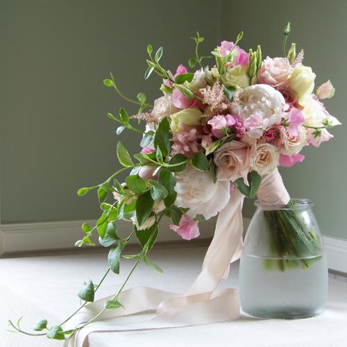 pink white cascading bouquet roses lisianthus Via  Floral Verde
