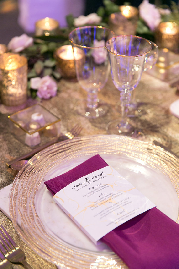 Gold charger with fuchsia napkin and custom menu wrap