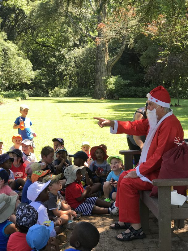 Father Christmas visits a kindergarten class in the park