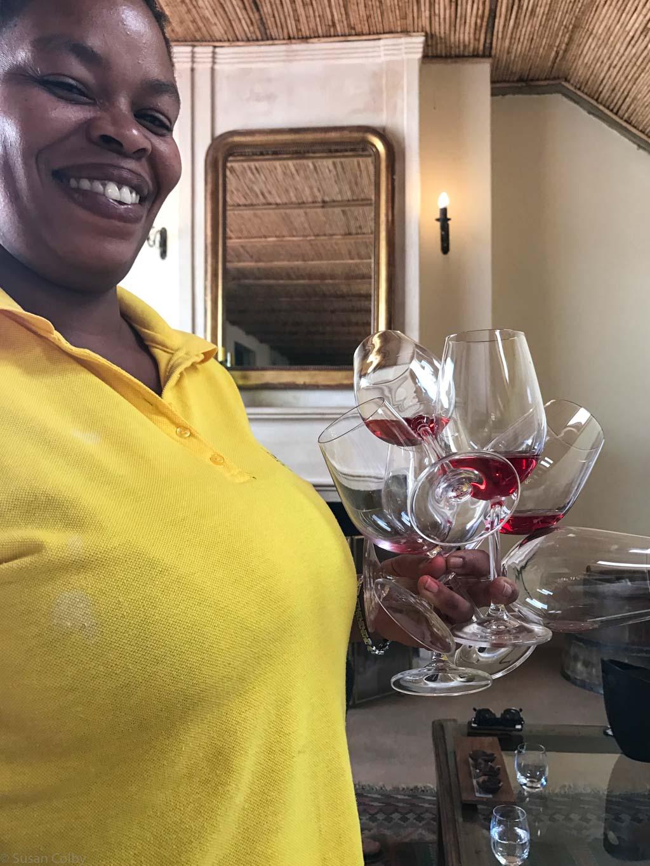 Our server at La Bri - note the clutch of wine glasses!