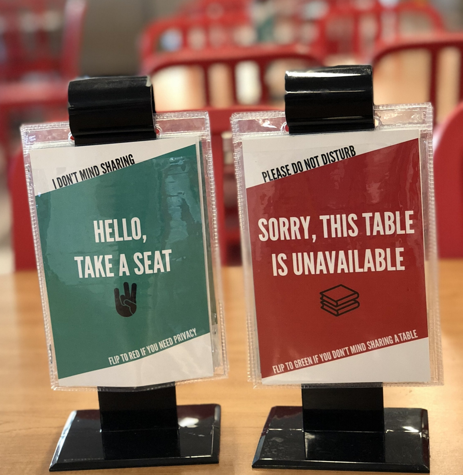 """Two Small signs, the first reads: """"Hello take a seat, I don't mind sharing"""", and the second reads: """"sorry, this table is unavailable, Please do not disturb"""". Links to Blog Page of this site."""
