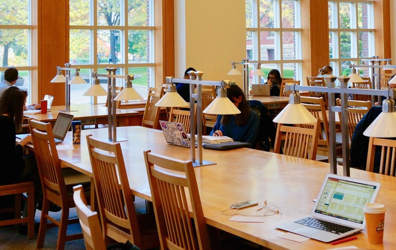 College students studying at tables in a college library. Links to The BLOG PAGE OF THIS SITE.
