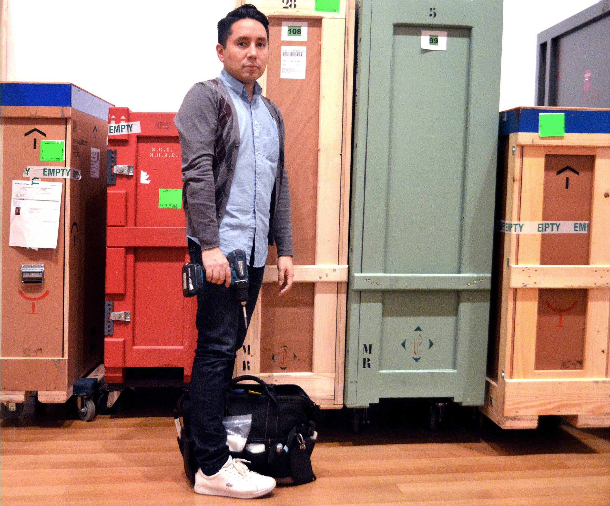 Hinojosa at work as a MoMA Preparator