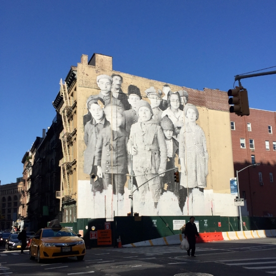 Ellis Island Immigrants plastered by JR at 100 Franklin, New York (Photo by Jacque Donaldson)