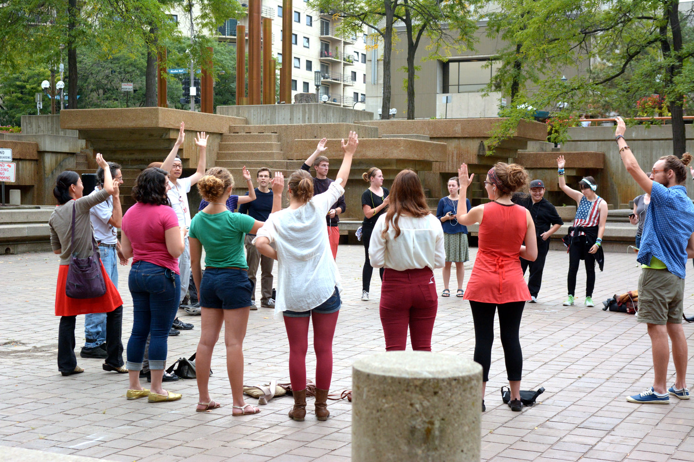 Raising+hands+in+circle.jpg