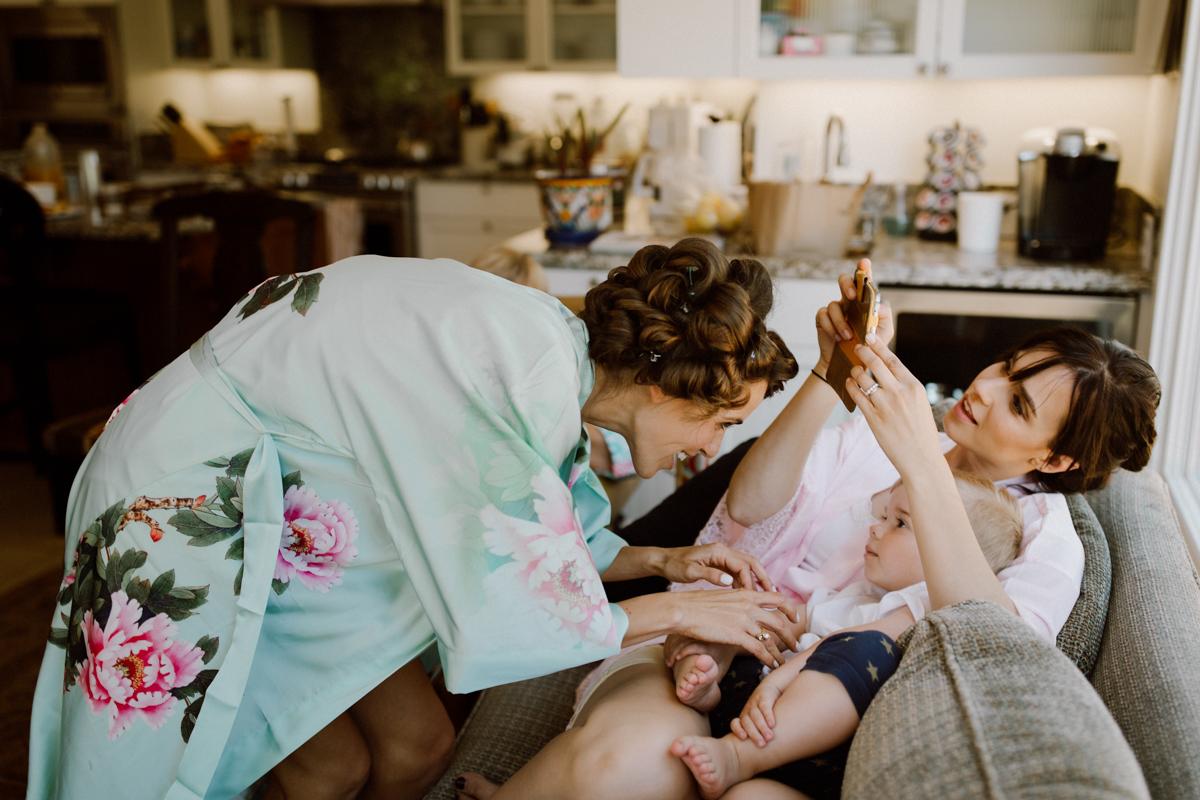 Betsy tickling her little nephew.