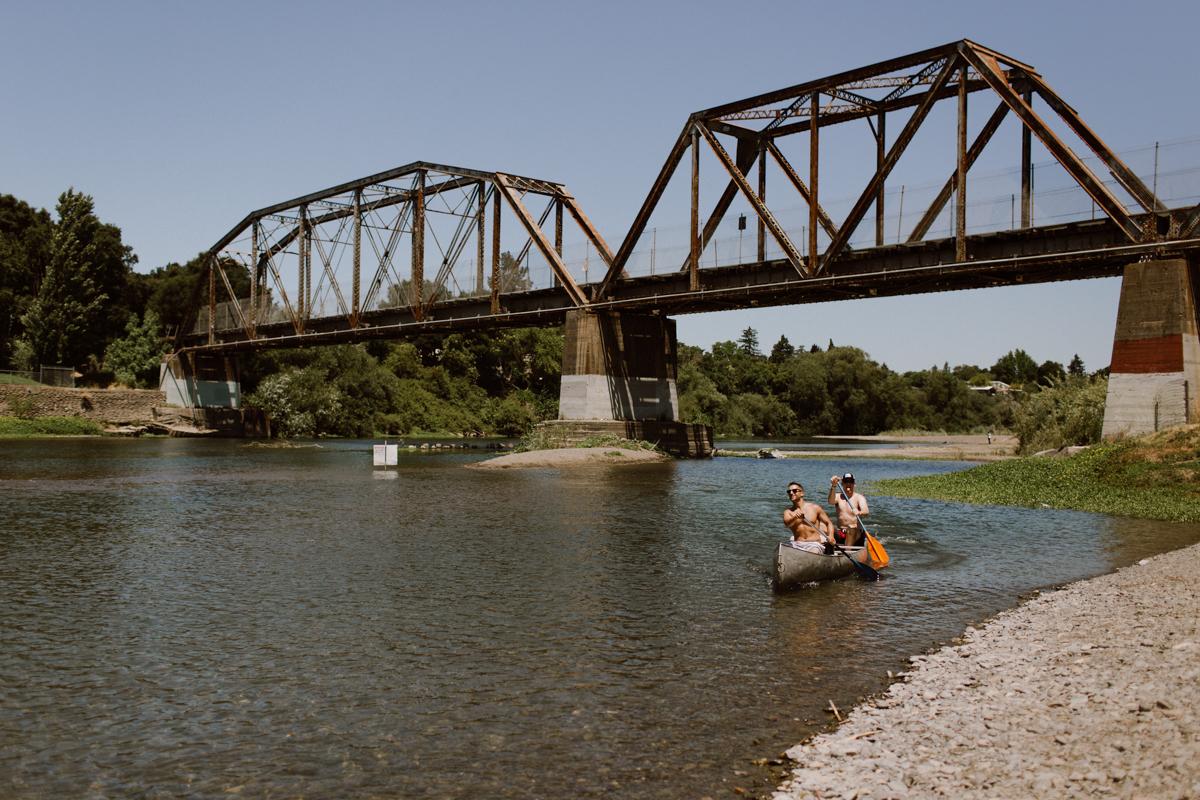 Groomsmen canoeing the Russian River.