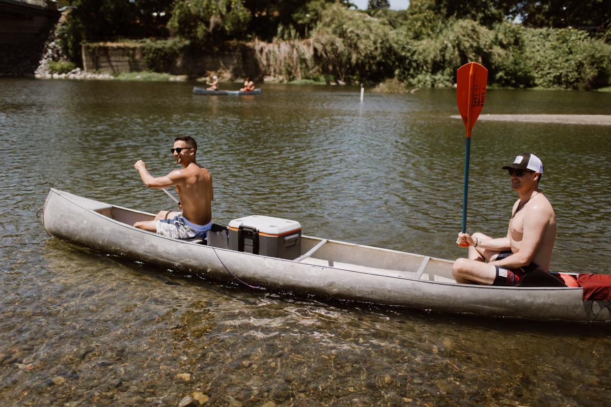Groomsmen in a canoe on the Russian River.