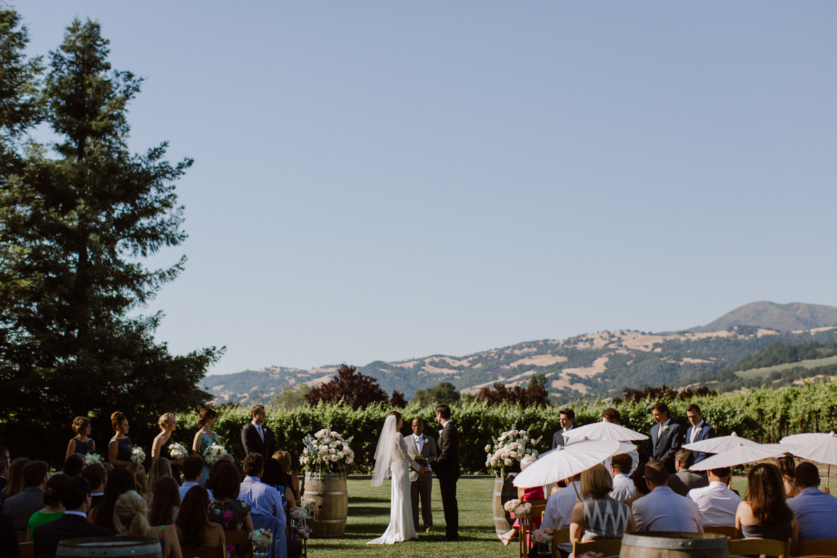 Adam & Betsy's ceremony with a view of the moutains behind them.
