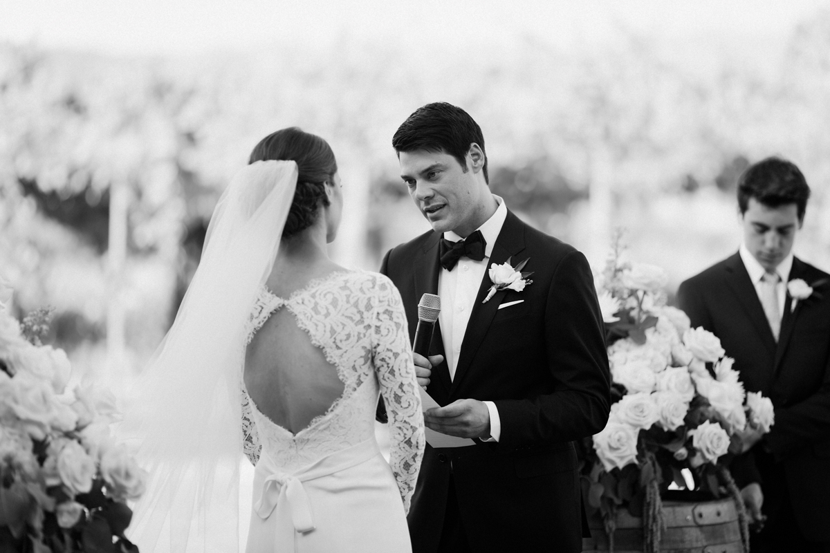 Adam reading his wedding vows to Betsy.