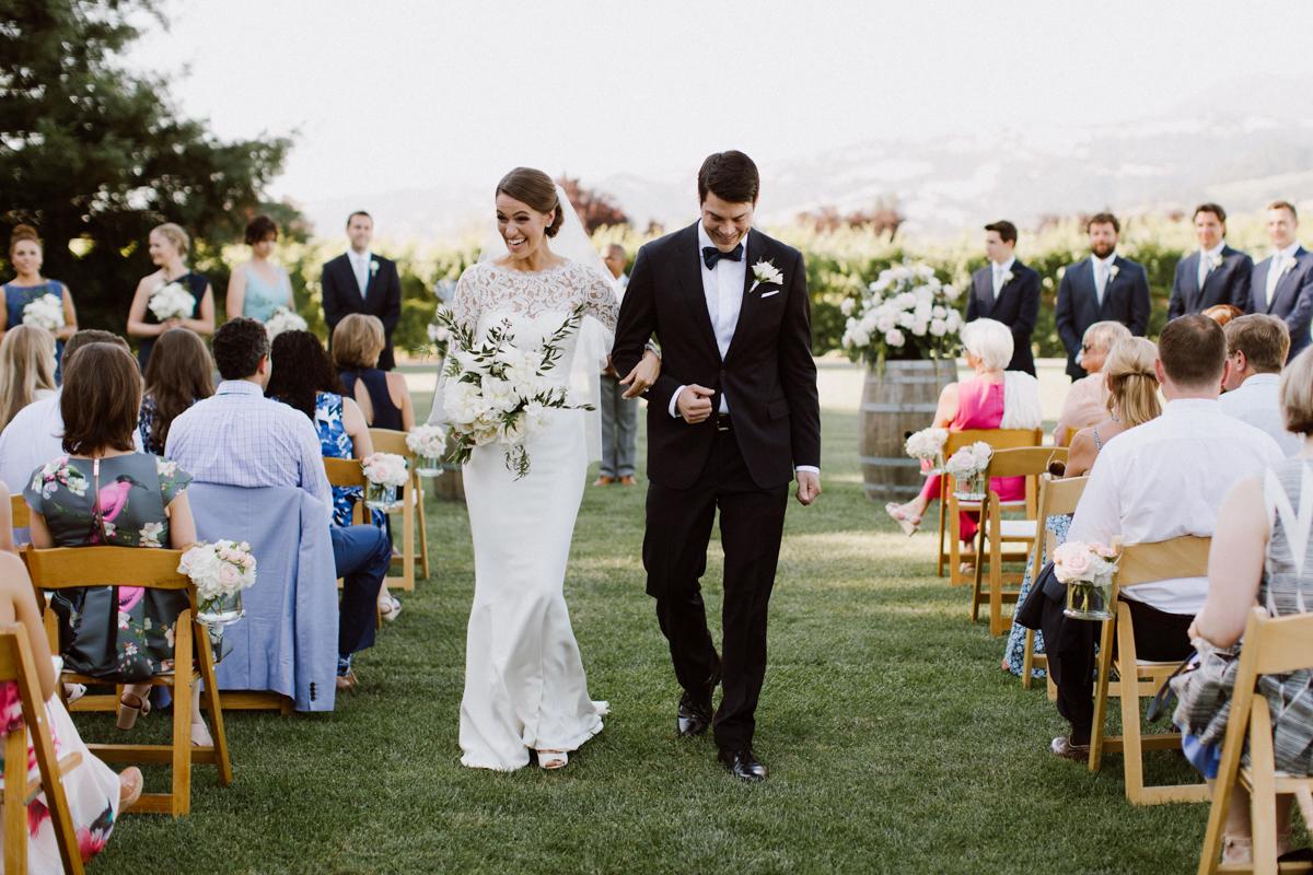 Adam & Betsy walk down the isle as husband & wife.