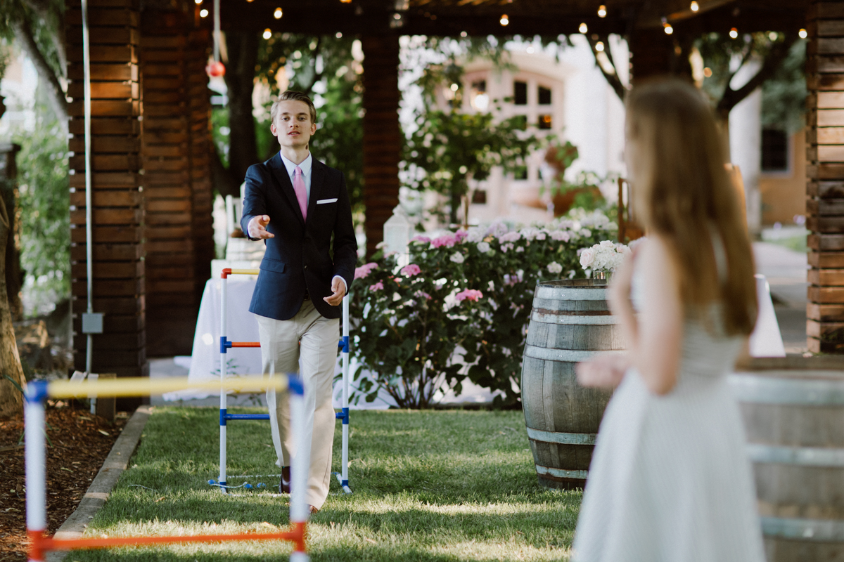 Wedding guest playing lawn games.