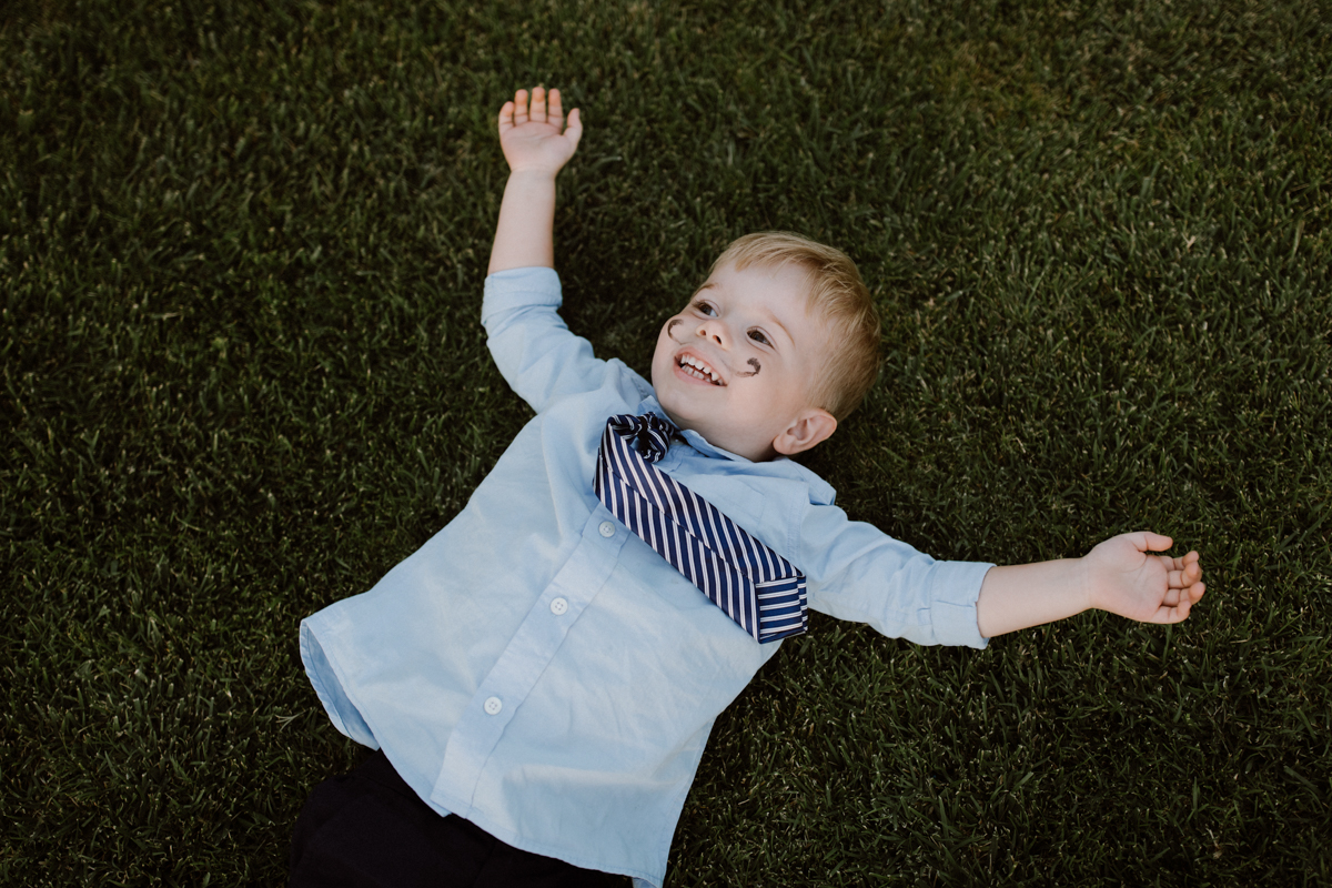 Betsy's little nephew laying on the lawn.