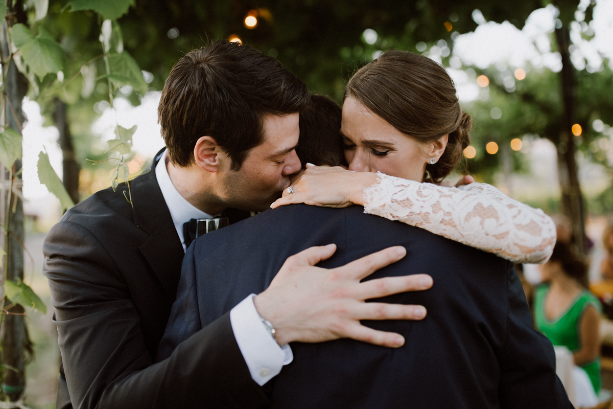 Adam & Betsy hugging younger brother