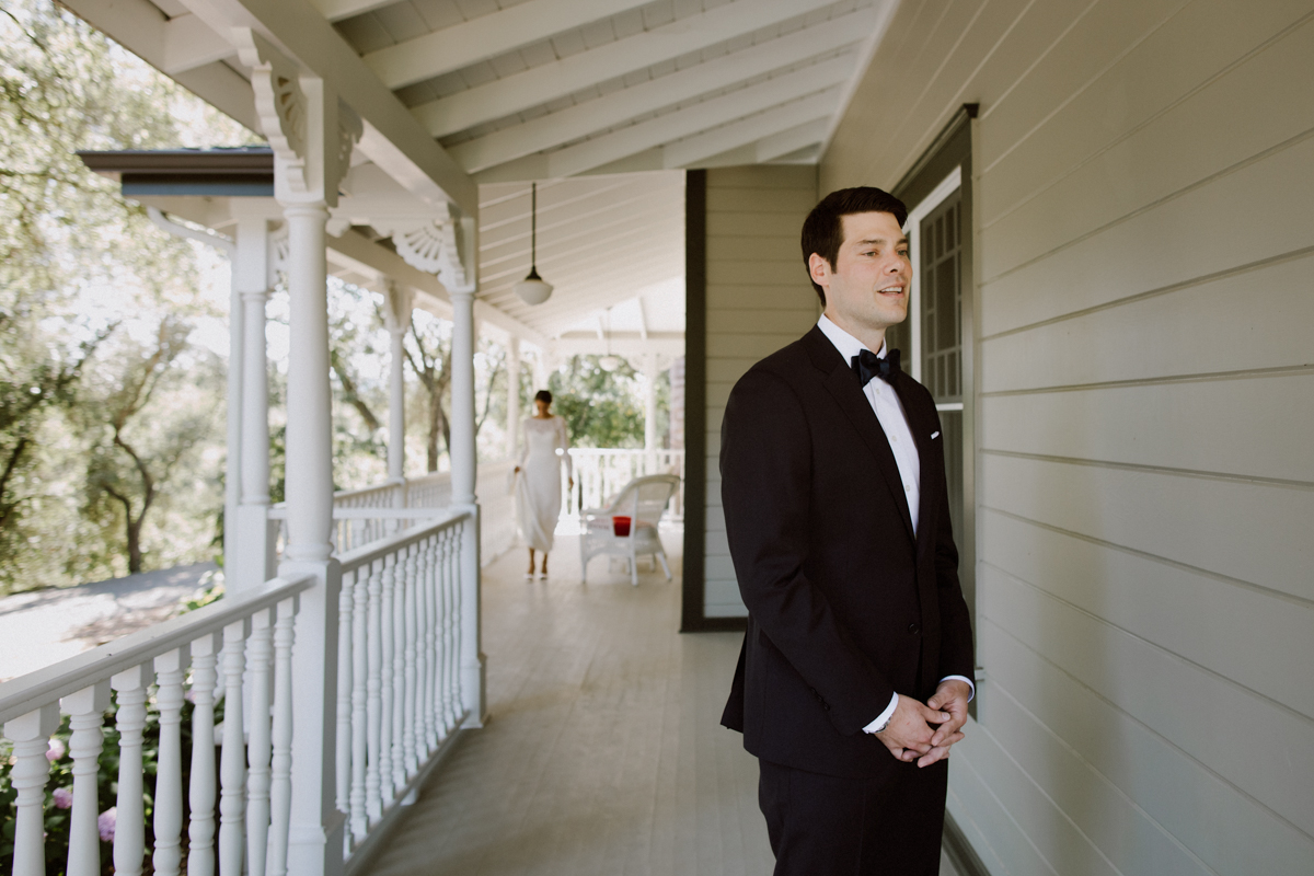 Adam waiting on front porch, ready for the first look.