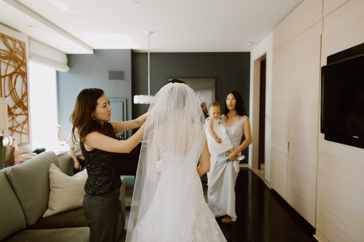 Bride putting on wedding dress at the St. Regis San Francisco.