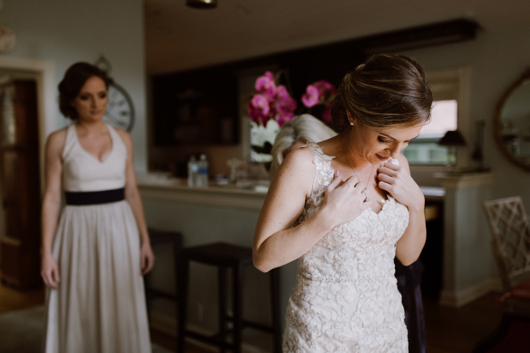 Bride putting on wedding dress at the Nestldown guest house.