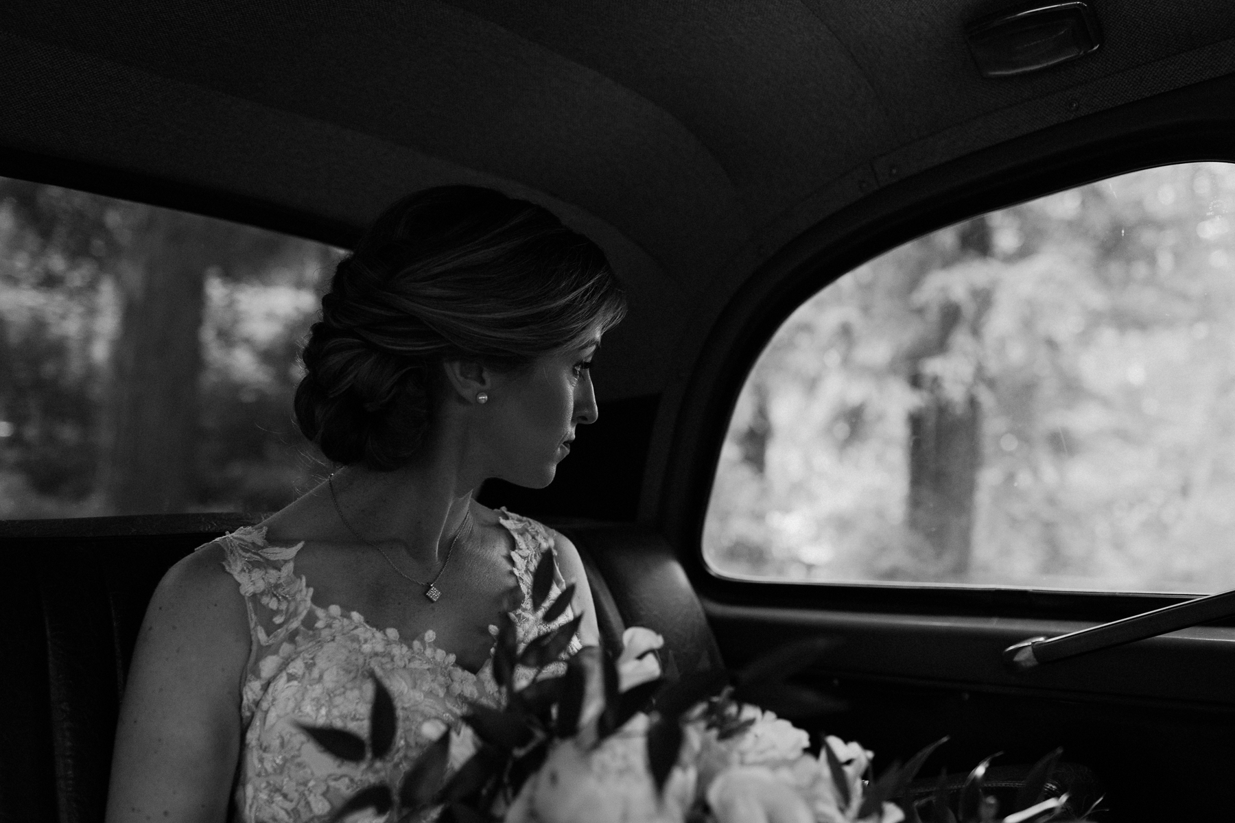 Bride in old classic taxi.