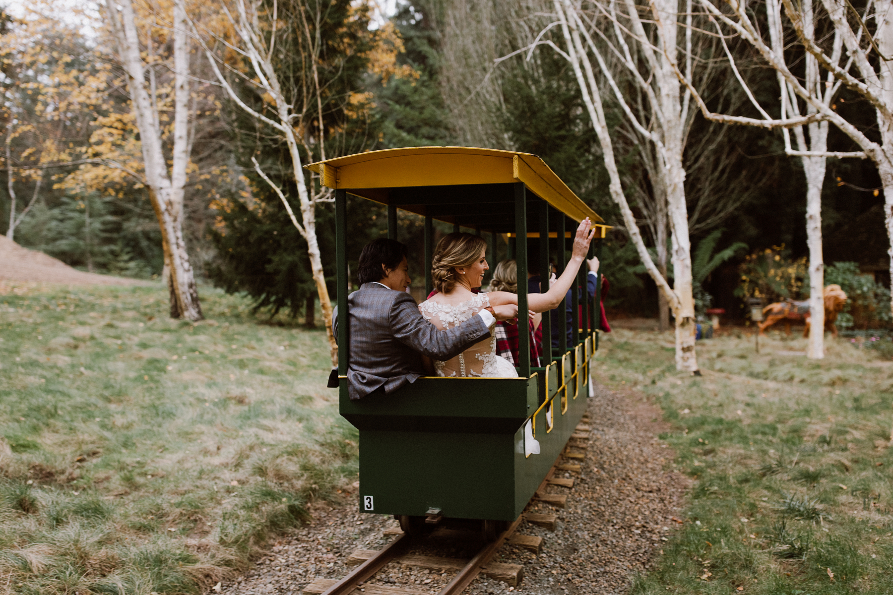 Bride & Groom riding the train at Nestldown.