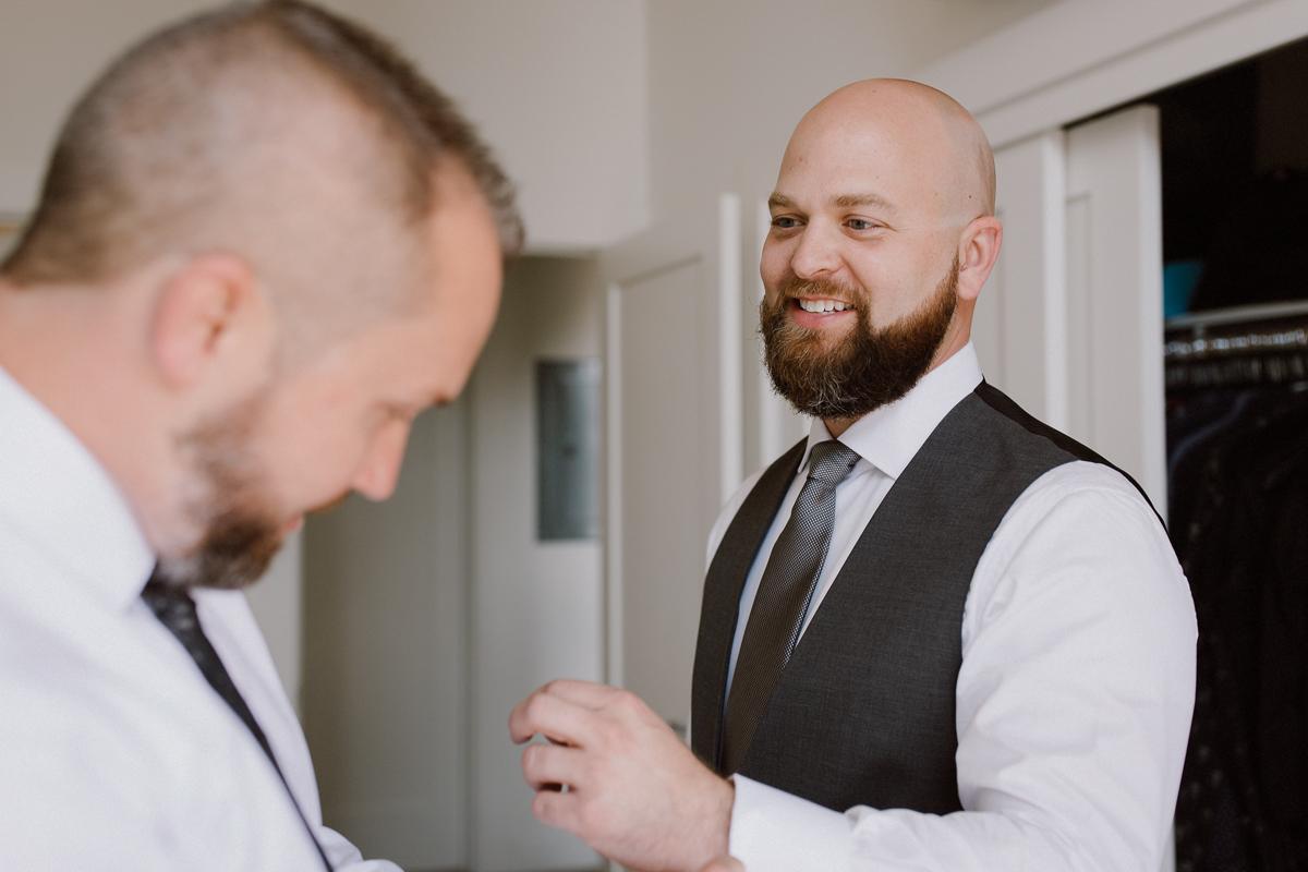 Helping same sex partner get dressed on wedding day