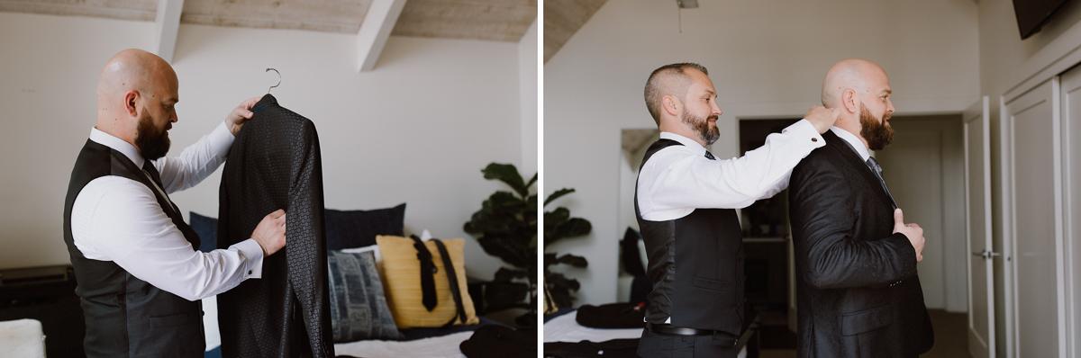Helping same sex partner put on jacket