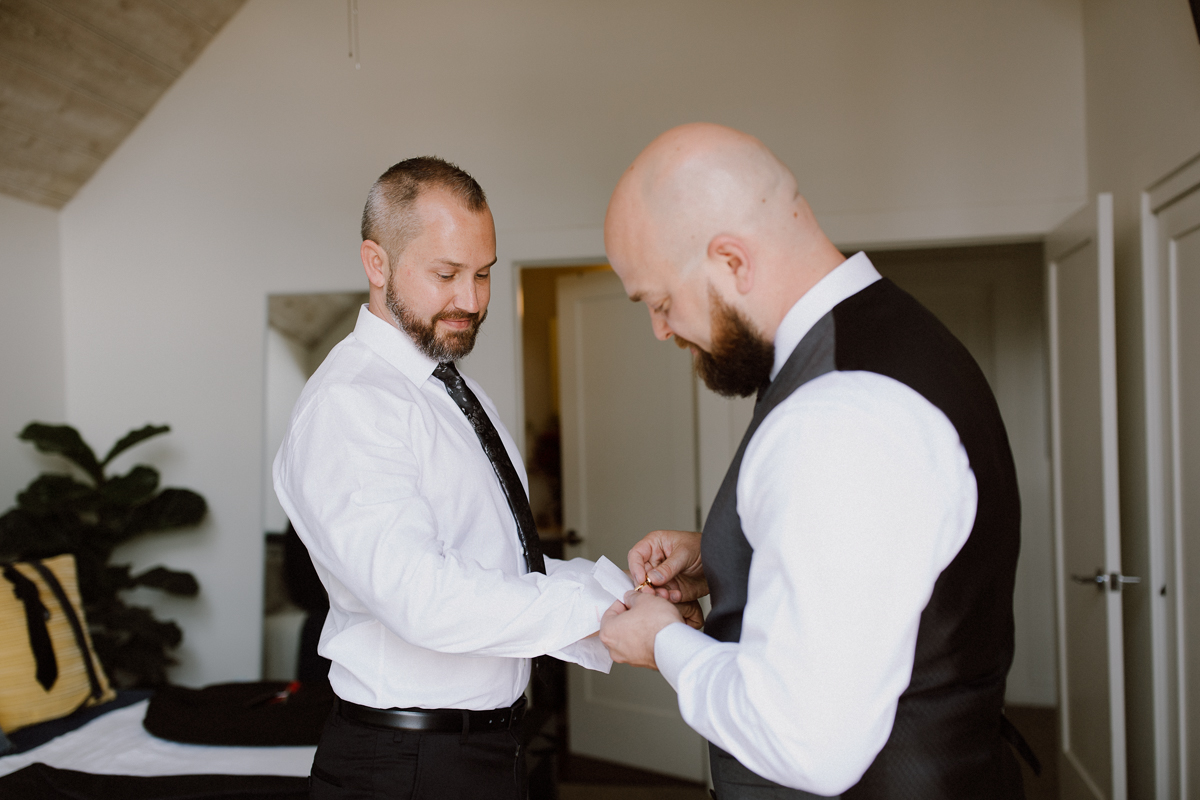 Same sex partners getting ready in the same room