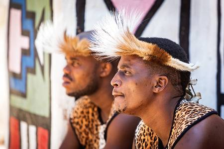 70159364-lesedi-cultural-village-south-africa-november-4-2016-two-young-male-zulu-tribe-members-wearing-tradi.jpg