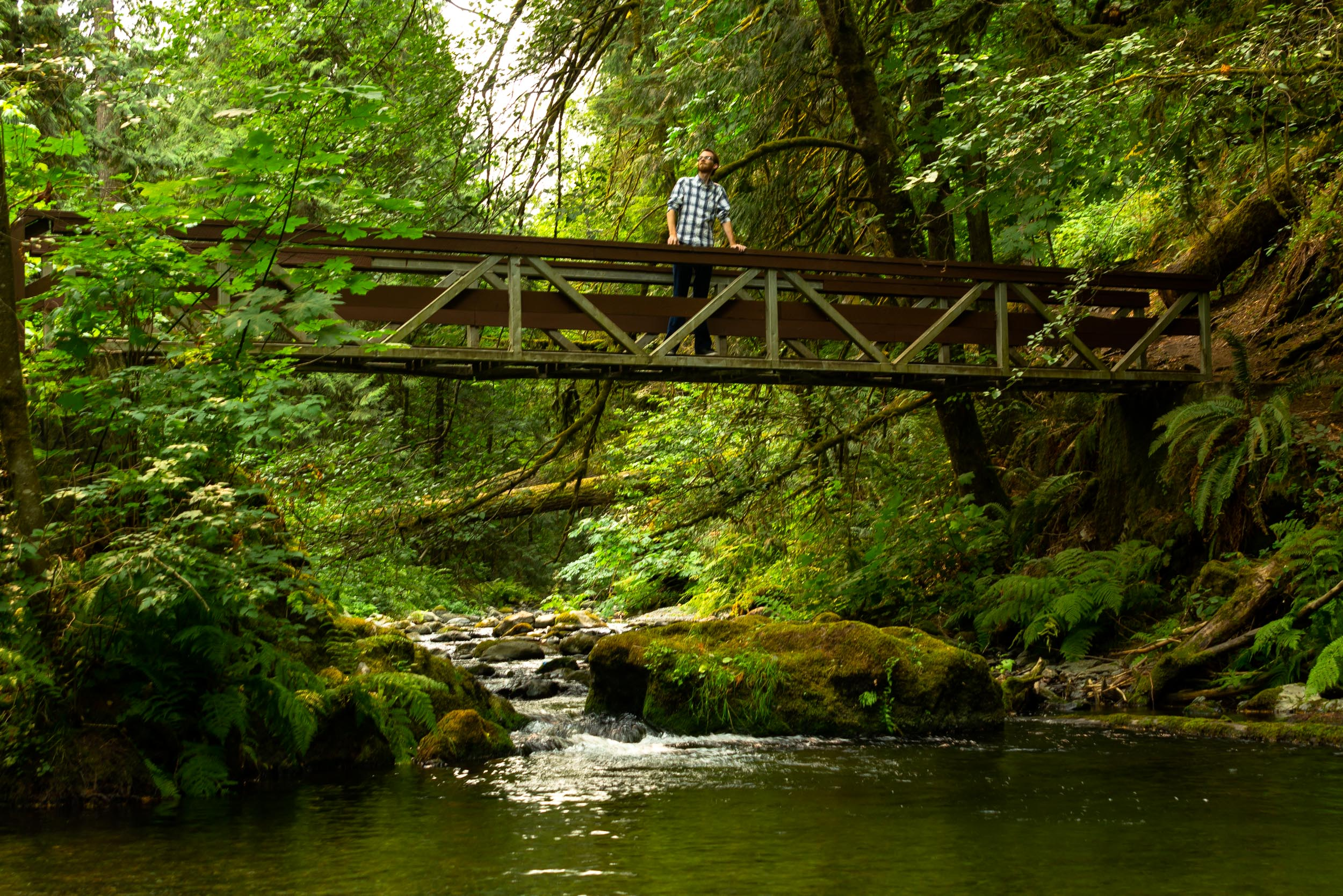 Posing on a bridge - Goldstream Provincial Park, Vancouver Island  Copyright © Afro Boy Productions. All rights reserved.