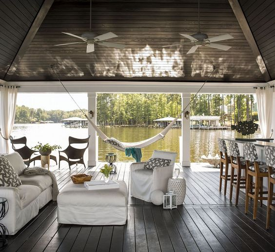 """Heather Garrett interior design created the traditional boat dock with what's become known as the """"party dock"""". The pillows and bar stool fabric is also by Sunbrella."""