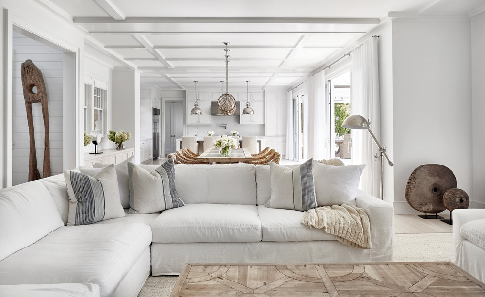 Such a cozy inviting family room...white slip covers and pillows by  Chango & Co.