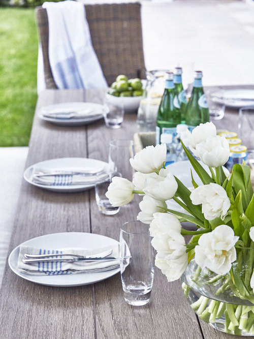 Simplicity...I love a simple table for an afternoon lunch by the pool... a bouquet of flowers with one type of flower adds a tranquil touch. Similar  White ad Blue Napkins