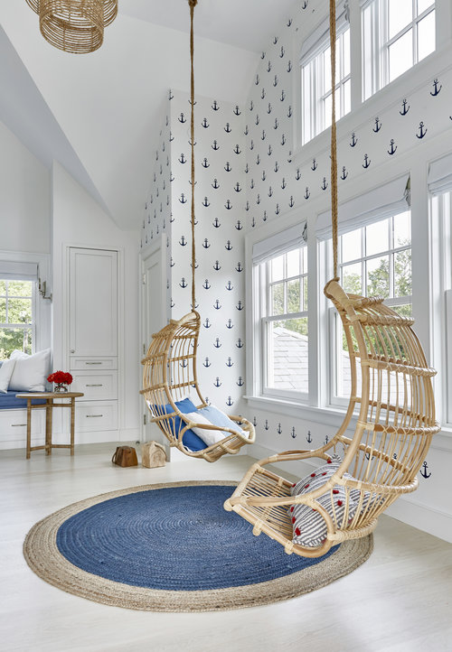 The kids can chill in these hanging wicker chairs from  Serena & Lily , hopefully they share. This  anchor wallpaper decor  is precious for a boy's bedroom